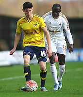 Callum O'Dowda of Oxford United and Modou Barrow of Swansea   during the Emirates FA Cup 3rd Round between Oxford United v Swansea     played at Kassam Stadium  on 10th January 2016 in Oxford