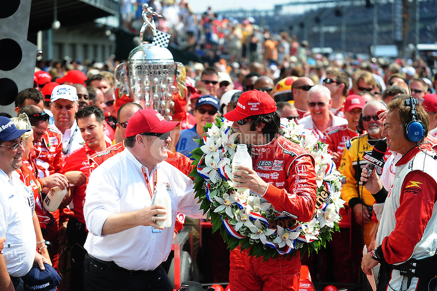 May 30, 2010; Indianapolis, IN, USA; IndyCar Series driver Dario Franchitti (right) celebrates with car owner Chip Ganassi after winning the Indianapolis 500 at the Indianapolis Motor Speedway. Mandatory Credit: Mark J. Rebilas-