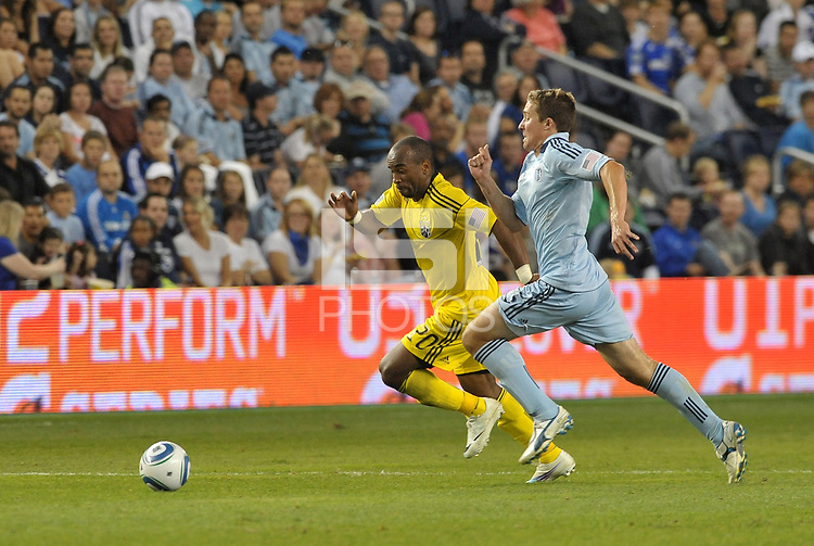 Emillio Renteria (20) forwaed Columbus Crew goes past Sporting KC defender Matt Besler... Sporting Kansas City defeated Columbus Crew 2-1 at LIVESTRONG Sporting Park, Kansas City, Kansas.