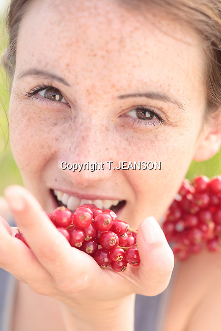 girl eating red grape