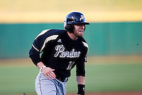 Andrew Dixon (11) of the Purdue Boilermakers rounds third base during a game against the Missouri State Bears at Hammons Field on March 13, 2012 in Springfield, Missouri. (David Welker / Four Seam Images)
