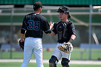 GCL Marlins pitcher Codie Paiva (39) and catcher Keegan Fish (7) celebrate after closing out a Gulf Coast League game against the GCL Astros on August 8, 2019 at the Roger Dean Chevrolet Stadium Complex in Jupiter, Florida.  GCL Marlins defeated GCL Astros 5-4.  (Mike Janes/Four Seam Images)
