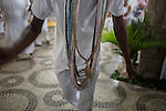 RIO DE JANEIRO, BRAZIL - JANUARY 24: Cassiano Linhares performs a ritual in a candomble ceremony, in Rio de Janeiro, Brazil, on Saturday, Jan. 23, 2015. Practitioners perform specific dances which enables them to become possessed by the orixas. Brazil's Afro-Brazilian religions which in recent years have come under increasing threats and prejudice, particularly from the growing number of evangelical churches. Candombl&eacute; originated in Salvador, Bahia at the beginning of the 19th century when enslaved Africans brought their beliefs with them. Umbanda and candombl&eacute; are Afro-Brazilian religions practiced in mostly Brazil. <br /> (Lianne Milton for the Washington Post)