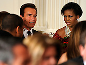 Washington, DC - February 22, 2009 -- First lady Michelle Obama (R) and California Gov. Arnold Schwarzenegger seated at black-tie dinner at the White House, Sunday, February 22, 2009.  The National Governors Association has been holding their 2009 Winter Meeting this weekend, where the nation's governors have been discussing Obama's stimulus program, as well as health care, infrastructure and education. .Credit: Mike Theiler / Pool via CNP