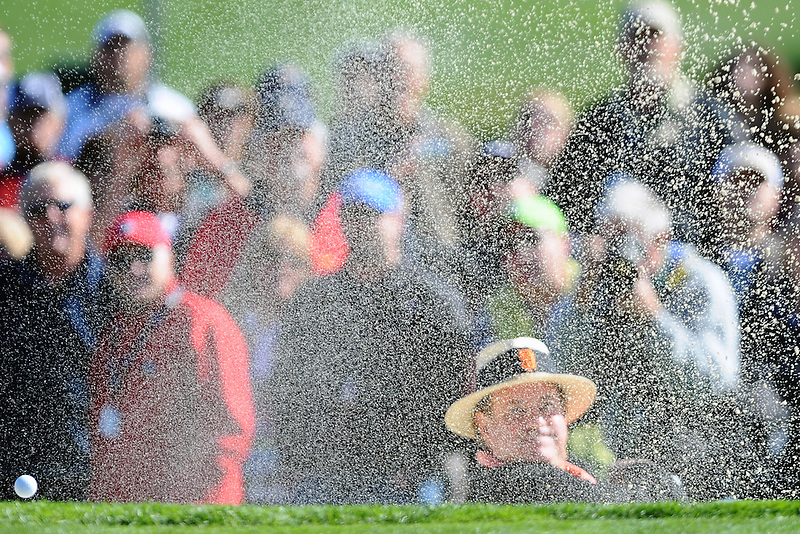 """ESPN sportscaster Chris """"Boomer"""" Berman chips a shot out of the sand on the third hole at Pebble Beach Golf Links during the 3M Celebrity Challenge during the 2012 AT&T Pebble Beach National Pro-Am."""