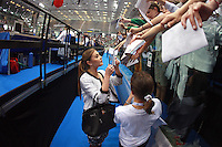 Alina Kabaeva of Russia (2004 Olympic gold winner) signs autographs for fans at 2008 European Championships at Torino, Italy on June 6, 2008.  Photo by Tom Theobald.