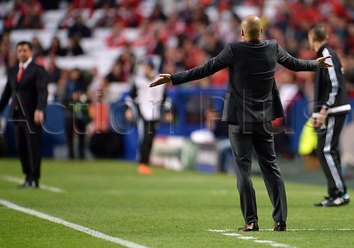 13.04.2016. Lisbon, Portugal.  Munich's coach Josep Pep Guardiola (R) reacts during the UEFA Champions League quarterfinal second leg soccer match between SL Benfica and FC Bayern Munich at Luz Stadium in Lisbon, Portugal, 13 April 2016.