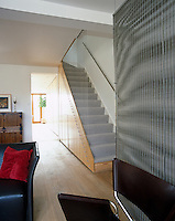 A view of the staircase and hallway from the living room