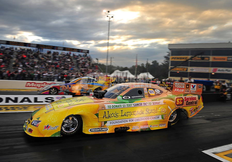 Sept. 30, 2011; Mohnton, PA, USA: NHRA funny car driver Johnny Gray (near lane) races alongside Jim Head during qualifying for the Auto Plus Nationals at Maple Grove Raceway. Mandatory Credit: Mark J. Rebilas-
