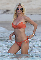 Victoria Silvstedt enjoys a beach day in a sexy bikinii while vacationing in Saint Barths