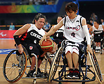 Tracey Ferguson (8) of Richmond Hill, Ont. has the ball stripped by Yuka Betto of Japan in women's wheelchair basketball action at the Paralympic Games in Beijing,Tuesday, Sept., 9, 2008.    Photo by Mike Ridewood/CPC