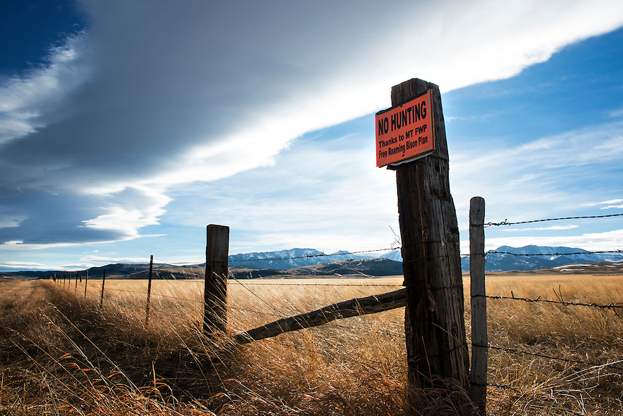 A no hunting sign is displayed on a fence post near the Crazy Mountains in western Montana.