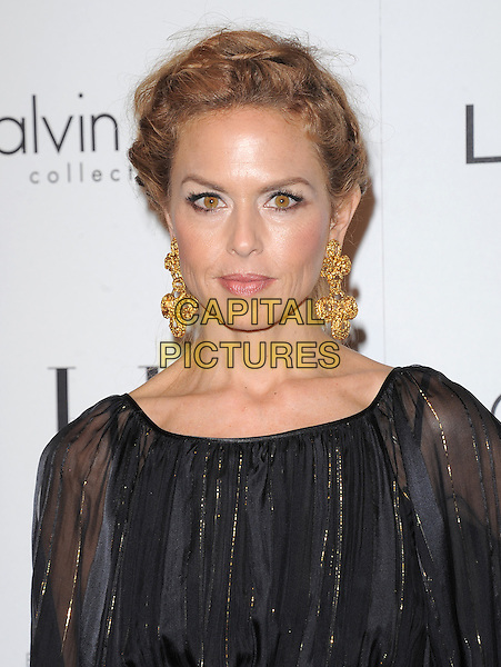 Rachel Zoe.18th Annual ELLE Women in Hollywood celebration held at The Four Seasons in Beverly Hills, California, USA..October 17th, 2011.headshot portrait black sheer gold earrings dangling hair up.CAP/RKE/DVS.©DVS/RockinExposures/Capital Pictures.