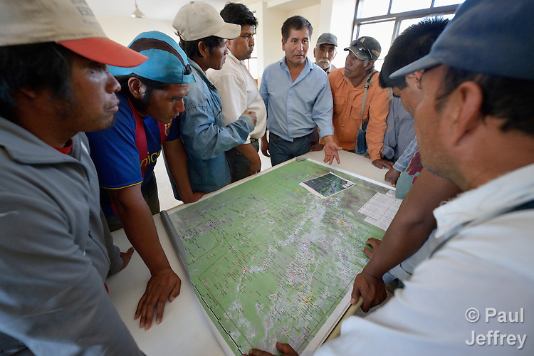 Wichi indigenous leaders in the Chaco region in northern Argentina discuss the division of land between their people and non-indigenous families living in the area, during a break in a negotiating session in Santa Victoria Este. The Wichi, who traditionally survived as hunter-gatherers, have struggled against the systematic expropriation of their land for over a century by mestizo cattleraisers who migrated into the region from elsewhere in Argentina. In 2014, the two groups finally agreed on a division of the land which recognizes the traditional land rights of the indigenous, and which resettles many mestizo families onto non-indigenous land. Church World Service has worked as a partner with local residents as they negotiated the landmark settlement.