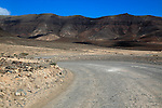 Unsurfaced road, barren rocky mountains, Jandia peninsula, Fuerteventura, Canary Islands, Spain