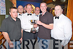 John Herlihy, winner of the Peig Murphy Cup darts competition in Murphys Bar, Killarney, pictured as he recieved the cup from Sean Murphy on Tuesday night. Also pictured are Brian Cahill, finalist, Dermot Kelliher, Roland Sauter and Denis Brosnan.....
