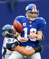 Eli Manning is sacked by Patrick Kerney, but it wasn't nearly enough as the  New York Giants beat the Seattle Seahawks 44-6 at Giants' Stadium in East Rutherford, NJ on Sunday October 5, 2008. (Photo by Scott Eklund)