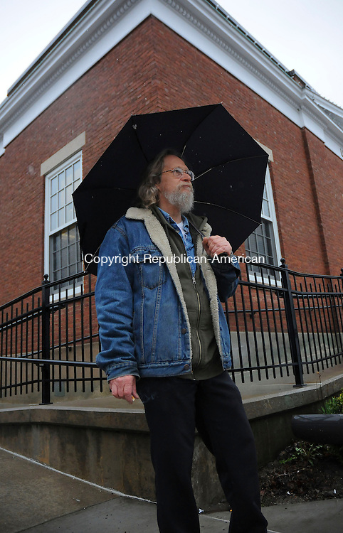 THOMASTON, CT-29 MARCH 2010-032910IP01-Gerald Barbetti of Thomaston waits in the rain for a ride home on Main St. in Thomaston on Monday. Barbetti said, &quot;Rain is nice except when you have to walk home in it&quot;. The rainy weather is expected to continue Tuesday.<br /> Irena Pastorello Republican-American