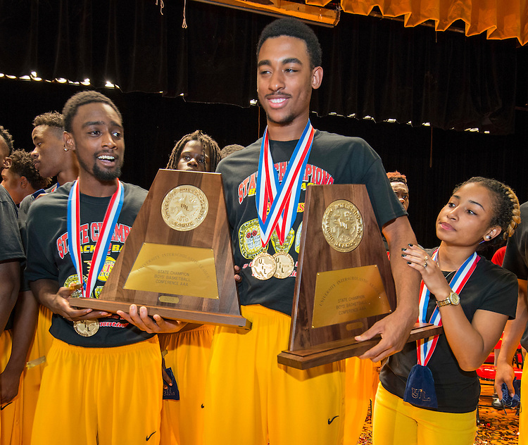Yates High School boys basketball teams are awarded the 2013 and 2014 UIL State Championship trophies during a celebration at Yates High School, September 2, 2014., 2014.
