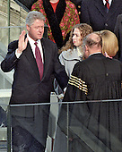 United States President William Jefferson Clinton is sworn-in for his second term in office at the U.S. Capitol on Monday, January 20, 1997.  .Chief Justice of the U.S. William H. Rehnquist administers the oath of office.  Chelsea Clinton looks on..Credit: Arnie Sachs / CNP