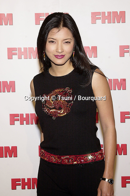 Kelly Hu - Martial Law -  arriving at The magazine FHM salutes the 100 sexist women of the world at La Boheme cafe in Los Angeles 5/17/2001  © Tsuni          -            HuKelly_MartialLaw06.jpg
