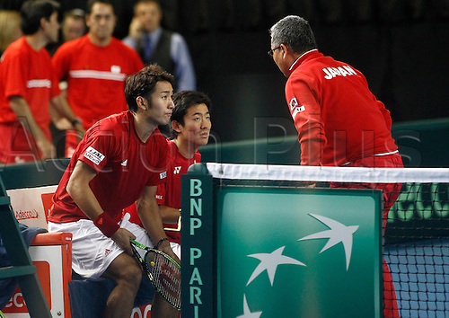 05.03.2016. Barclaycard Arena, Birmingham, England. Davis Cup Tennis World Group First Round. Great Britain versus Japan. Japan team captain Minoru Ueda coaches Yasutaka Uchiyama and Yoshihito Nishioka during their match against Andy Murray and Jamie Murray. GB won in straight sets 6-3, 6-2, 6-4.