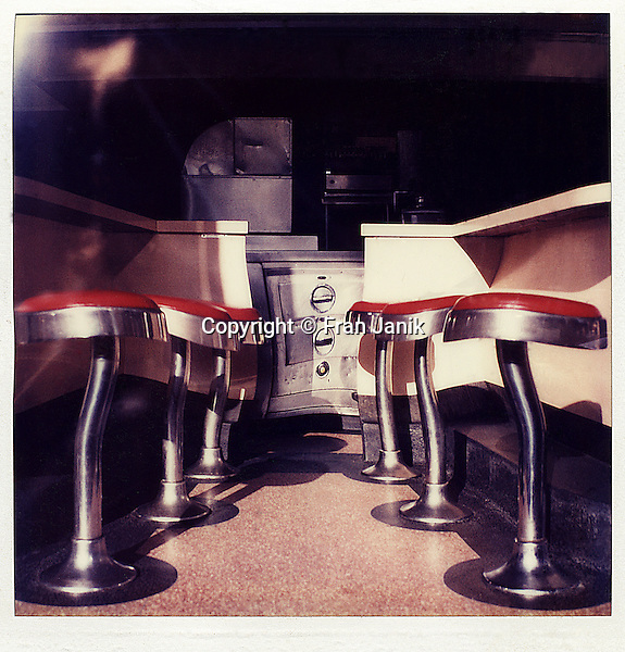 Six diner stools dance in a chock full of nuts in lower manhatten. The original image is sx70 polaroid.