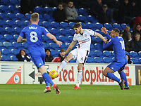 Bolton Wanderers' Dorian Dervite clears despite the attentions of Cardiff City's Kenneth Zohore<br /> <br /> Photographer Kevin Barnes/CameraSport<br /> <br /> The EFL Sky Bet Championship - Cardiff City v Bolton Wanderers - Tuesday 13th February 2018 - Cardiff City Stadium - Cardiff<br /> <br /> World Copyright &copy; 2018 CameraSport. All rights reserved. 43 Linden Ave. Countesthorpe. Leicester. England. LE8 5PG - Tel: +44 (0) 116 277 4147 - admin@camerasport.com - www.camerasport.com
