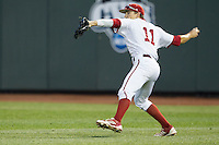 Indiana Hoosiers outfielder Wil Nolden (11) makes a throw from the outfield against the Mississippi State Bulldogs during Game 6 of the 2013 Men's College World Series on June 17, 2013 at TD Ameritrade Park in Omaha, Nebraska. The Bulldogs defeated Hoosiers 5-4. (Andrew Woolley/Four Seam Images)