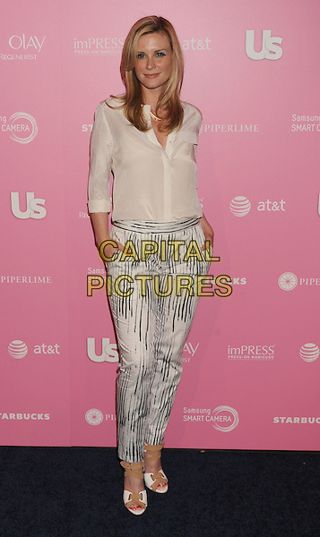 Bonnie Somerville.arriving at Us Weekly's Hot Hollywood 2012 Style Issue Event at Greystone Manor Supperclub in West Hollywood, California, USA, .April 18th, 2012.  .full length white shirt trousers print hands in pockets .CAP/ROT/TM.©TM/Roth Stock/Capital Pictures