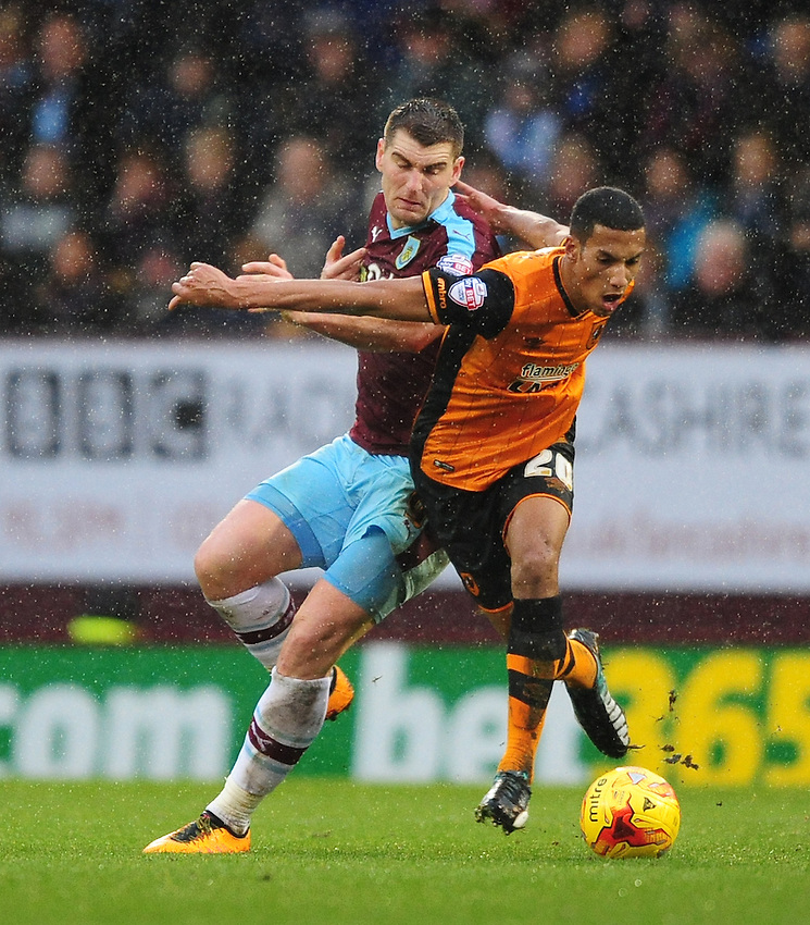 Hull City's Isaac Hayden is fouled by Burnley's Sam Vokes<br /> <br /> Photographer Chris Vaughan/CameraSport<br /> <br /> Football - The Football League Sky Bet Championship - Burnley v Hull City - Saturday 6th February 2016 - Turf Moor - Burnley <br /> <br /> &copy; CameraSport - 43 Linden Ave. Countesthorpe. Leicester. England. LE8 5PG - Tel: +44 (0) 116 277 4147 - admin@camerasport.com - www.camerasport.com