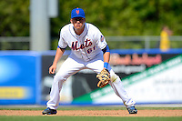 New York Mets infielder Wilmer Flores #61 during an exhibition game against the Michigan Wolverines at Tradition Field on February 24, 2013 in St. Lucie, Florida.  New York defeated Michigan 5-2.  (Mike Janes/Four Seam Images)