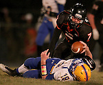 HOWARD, SD - NOVEMBER 8:  Thad Henkel #7 from Howard sacks quarterback Grant Johnson #18 from Alcester Hudson in the first half of their Class 9A Semifinal game Saturday night in Howard. (Photo by Dave Eggen/Inertia)