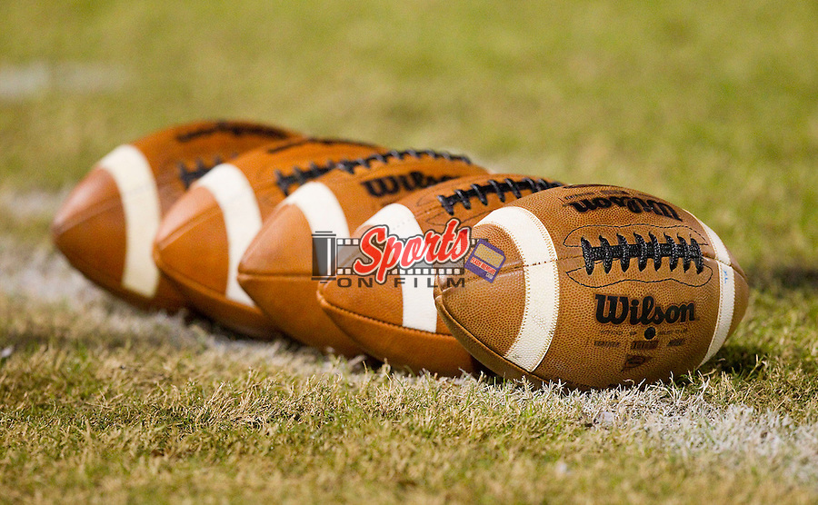 Wilson footballs sit on the sideline prior to the game between the A.L. Brown Wonders and the Northwest Cabarrus Trojans at Trojan Stadium October 21, 2011, in Concord, North Carolina.  The Wonders defeated the Trojans 44-7.  (Brian Westerholt/Sports On Film)