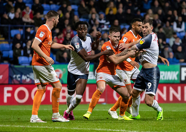 Bolton Wanderers' Joe Dodoo (2nd left) and Daryl Murphy (right) jostle for position with Blackpool's defence<br /> <br /> Photographer Andrew Kearns/CameraSport<br /> <br /> The EFL Sky Bet League One - Bolton Wanderers v Blackpool - Monday 7th October 2019 - University of Bolton Stadium - Bolton<br /> <br /> World Copyright © 2019 CameraSport. All rights reserved. 43 Linden Ave. Countesthorpe. Leicester. England. LE8 5PG - Tel: +44 (0) 116 277 4147 - admin@camerasport.com - www.camerasport.com