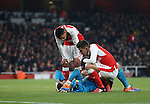 Arsenal's Francis Coquelin and Gabriel look at Emiliano Martinez after he gets hurt during the EFL Cup match at the Emirates Stadium, London. Picture date October 30th, 2016 Pic David Klein/Sportimage