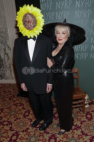 "NEW YORK, NY - OCTOBER 31 : Max Von Haselberg (L) and Singer/Actress Bette Midler arrive for the New York Restoration Project's 19th Annual Hulaween Gala ""FELLINI HULAWEENI"" held at the Waldorf Astoria on October 31, 2014 in New York City.  (Photo by Brent N. Clarke / MediaPunch)"