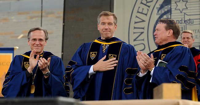NBC Nightly News anchor Brian Williams acknowledges the applause of the crowd after delivering the Commencement address at the 2010 University of Notre Dame Commencement ceremony in Notre Dame Stadium May 16, 2010. ..Photo by Joe Raymond/University of Notre Dame