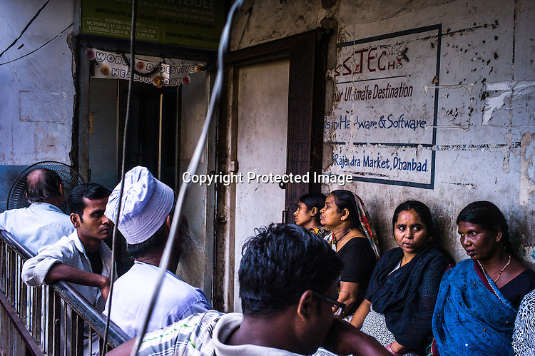 Patients wait to see the tuberculosis specialist, Dr. Chatterjee in his clinic in Dhanbad in Jharkhand, India.  Photo: Sanjit Das/Panos