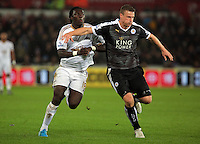 (L-R) Bafetimbi Gomis of Swansea challenged by Robert Huth of Leicester City  during the Barclays Premier League match between Swansea City and Leicester City at the Liberty Stadium, Swansea on December 05 2015
