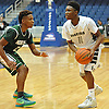 Travis Robinson-Morgan #11 of Elmont, right, gets pressured by Noah Shy #2 of Valley Stream North during the Nassau County varsity boys basketball Class A semifinals at Hofstra University on Wednesday, Feb. 24, 2016. Elmont won by a score of 77-54.