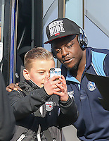 Adebayo Akinfenwa of Wycombe Wanderers poses for a photo with a young Grimsby supporter ahead of the Sky Bet League 2 match between Grimsby Town and Wycombe Wanderers at Blundell Park, Cleethorpes, England on 4 March 2017. Photo by Andy Rowland / PRiME Media Images.