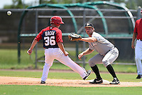 GCL Marlins first baseman Austen Smith (37) waits for a pickoff attempt throw as Kyle Bacak (36) gets back to the bag during a game against the GCL Nationals on June 28, 2014 at the Carl Barger Training Complex in Viera, Florida.  GCL Nationals defeated the GCL Marlins 5-0.  (Mike Janes/Four Seam Images)