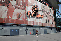 9th May 2020, Emirates  Stadium, London, England; Shirtless runner exercising outside the Emirates Stadium during the Covid-19 lockdown