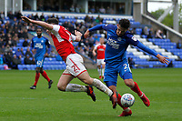 Lewis Coyle of Fleetwood Town and Liam Shephard of Peterborough United during the Sky Bet League 1 match between Peterborough and Fleetwood Town at London Road, Peterborough, England on 28 April 2018. Photo by Carlton Myrie.