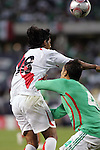 June 08 2008:  Juan Marino (Hercules / SPA) (18) of Peru and .Aaron Galindo (Eintracht Frankfurt / GER) (4) of Mexico battle for a loose ball.  During the third and final match of Mexico's 2008 USA Tour in preparation for qualification for FIFA's 2010 World Cup, the national soccer team of Mexico defeated Peru 4-0 at Soldier Field, in Chicago, IL.