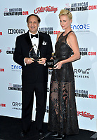 LOS ANGELES, USA. November 09, 2019: Charlize Theron & Adam Aron at the American Cinematheque Award Gala honoring Charlize Theron at the Beverly Hilton.<br /> Picture: Paul Smith/Featureflash