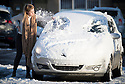08/12/17<br /> <br /> A woman scrapes snow and ice from a car in Buxton, after overnight snowfall in the Derbyshire Peak District.<br />   <br /> All Rights Reserved F Stop Press Ltd. +44 (0)1335 344240 +44 (0)7765 242650  www.fstoppress.com