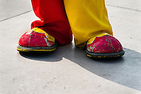A clown wears oversized red and yellow shoes during the Clown Congress in San Salvador, El Salvador, 18 May 2011. The clown performance is considered a regular job in most of Latin American countries. Clowns may work individually or in groups, often performing advertisement like acts in large open-to-street shops or they take part in private shows, like children birthdays, family events etc. There are many clown conventions all over Latin America where clowns gather and exchange their experiences offering workshops of the comic acting or the art of make-up. For some of them, being clown is a serious lifetime profession.