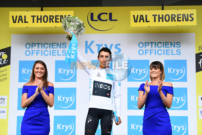 Yellow Jersey Egan Bernal (COL) Team Ineos on the podium knowing that he has won the race overall and also retaining the young riders White Jersey at the end of Stage 20 of the 2019 Tour de France running 59.5km from Albertville to Val Thorens, France. 27th July 2019.<br /> Picture: ASO/Alex Broadway | Cyclefile<br /> All photos usage must carry mandatory copyright credit (© Cyclefile | ASO/Alex Broadway)